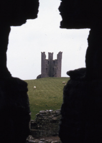 Haunted Britain- A view of Dunstanburgh Castle.