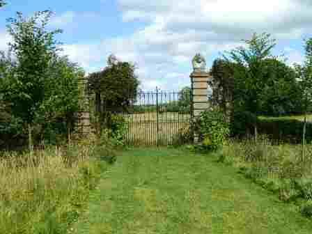 The locked gates of hellens Manor which have remained locked for over four hundred year.