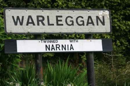 "Sign for the village of Warleggan reading that it is ""twinned with Narnia."""